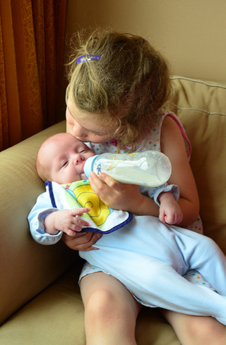 child bottle feeding baby