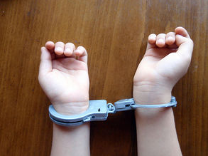 handcuffed kid