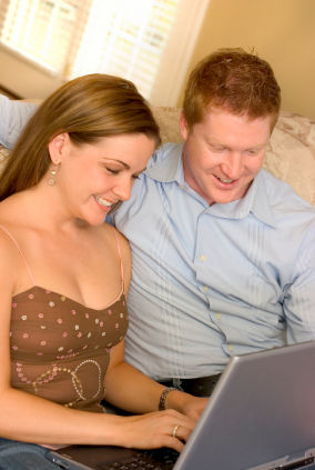 couple works on laptop together