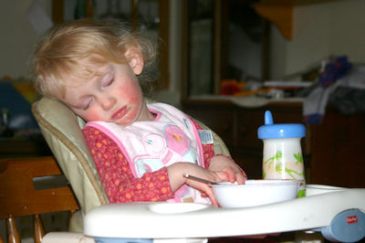 toddler asleep in high chair