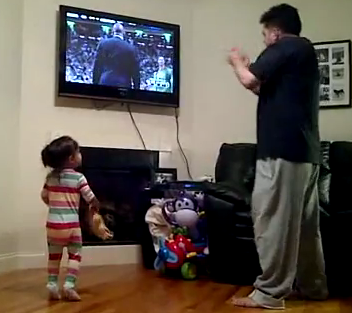 girl watching basketball with dad