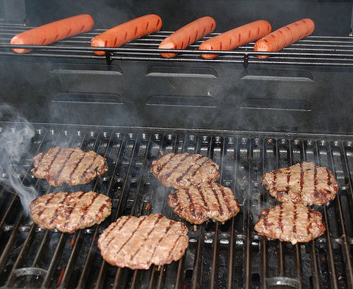 grilling burgers and dogs