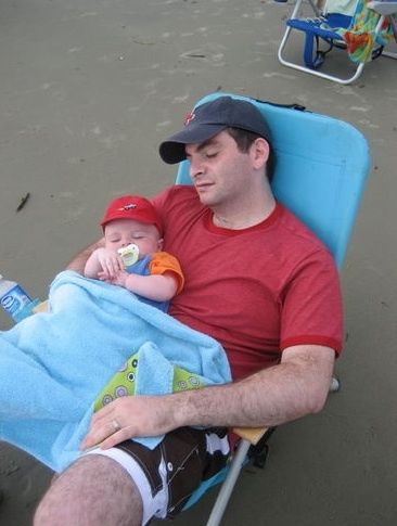 father in recliner with baby