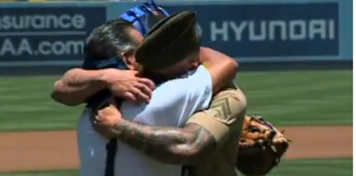 marine and dad hugging at dodger stadium