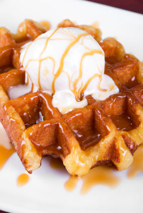 belgian waffle with ice cream and syrup