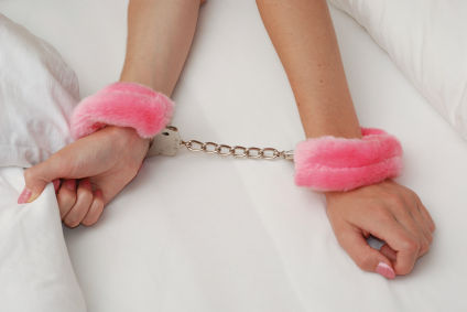 woman in pink furry handcuffs