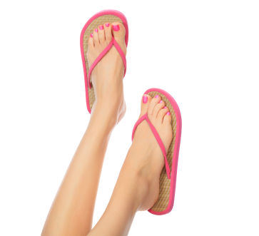 woman's feet in flip-flops