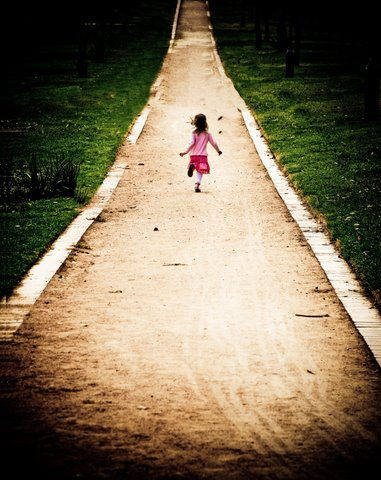 girl running away road path