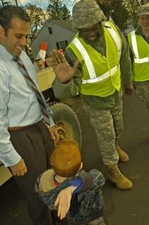 National guardsman greets a tyke after Hurricane Sandy