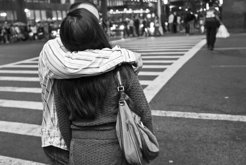 Couple kissing in a crosswalk