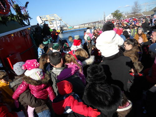 santa arrives by tugboat
