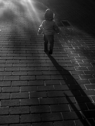 child walking shadow