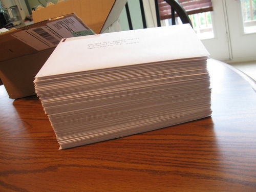 pile of wedding invitations