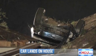 suv lands on house