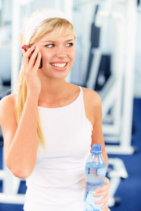 woman on cellphone at gym