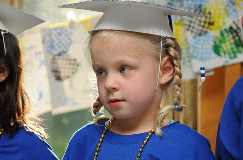little girl graduating
