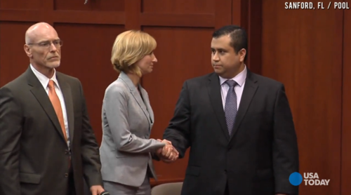george zimmerman shakes hands with attorney after being acquitted