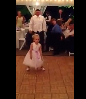 little girl dancing at wedding