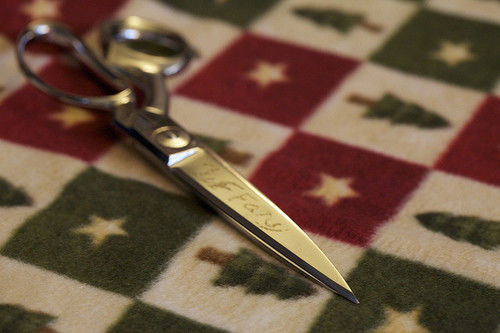 scissors and christmas wrapping paper