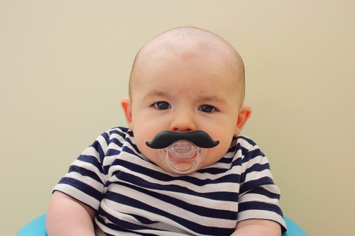 baby with moustache