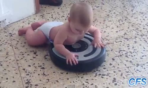 babies riding roombas