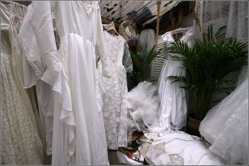 room filled with wedding dresses