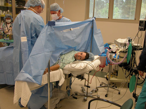 woman being operated on c-section hospital