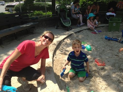 mom and son playing in sandbox