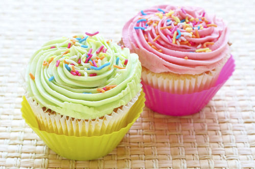 picture of cupcakes with frosting and sprinkles