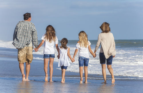 picture of a family walking on the beach