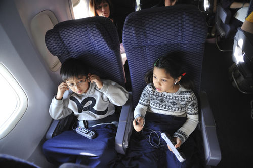 children on airplane flight