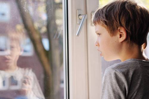 little boy looking out of the window