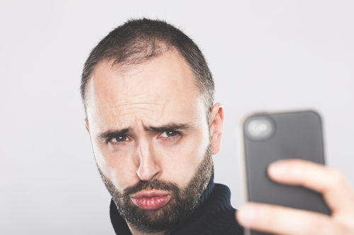 man taking selfie