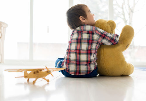 little boy hugging teddy bear