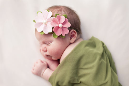 baby girl with a flower headband