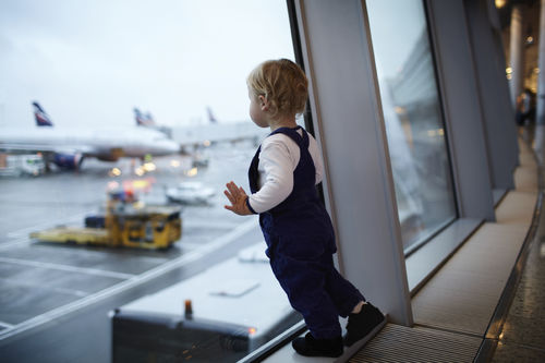 toddler in an airport terminal