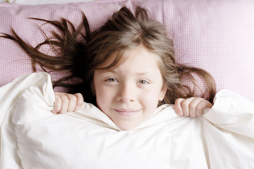 girl waking up for school