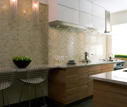 ceramic backsplash tile and quartz countertop with wood cabinets