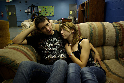 teen romance couple couch cuddling
