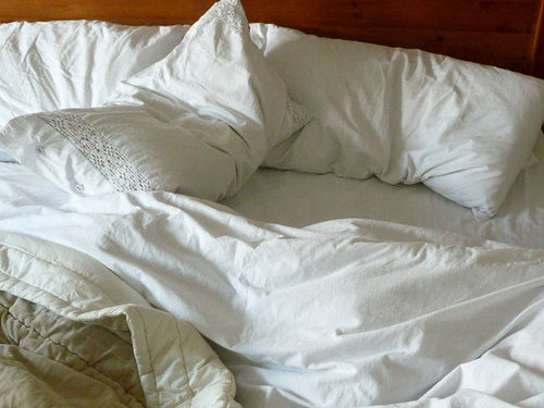 white bed linens sheets