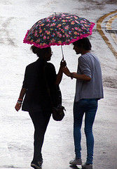 man and woman in rain