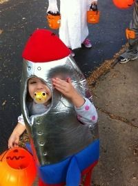kid in rocket ship costume