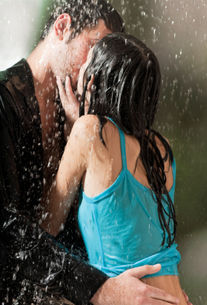 young couple kissing rain