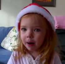 kid singing christmas songs