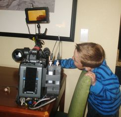 kid looking at tv camera