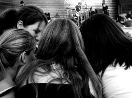 teen girls huddle