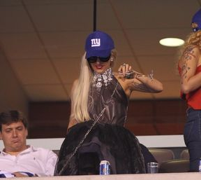 lady gaga spills champagne at giants game