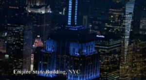 empire state building lit up blue for autism awareness