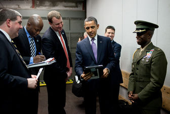 Obama checks out photos on an iPad