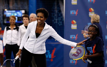 michelle obama playing tennis u.s. open